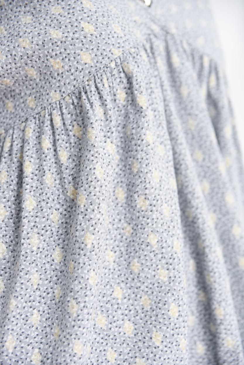 blusa manchas dourado