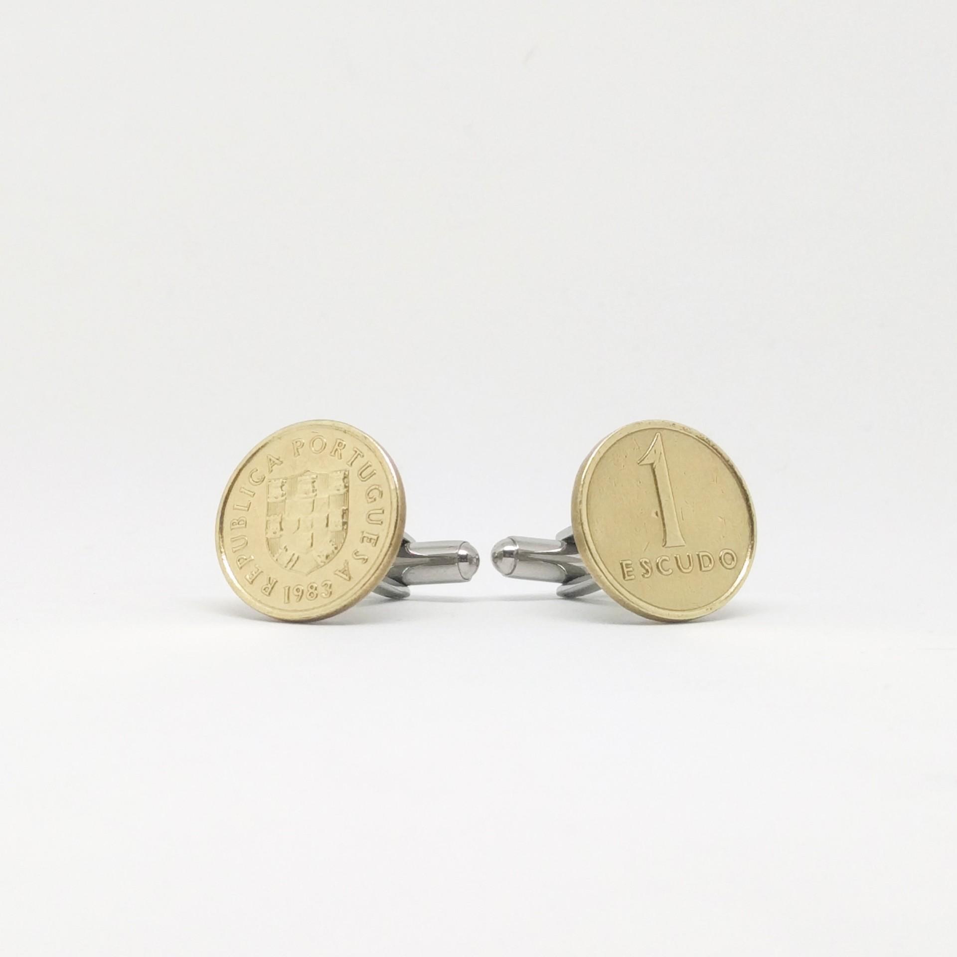 1$ Escudo