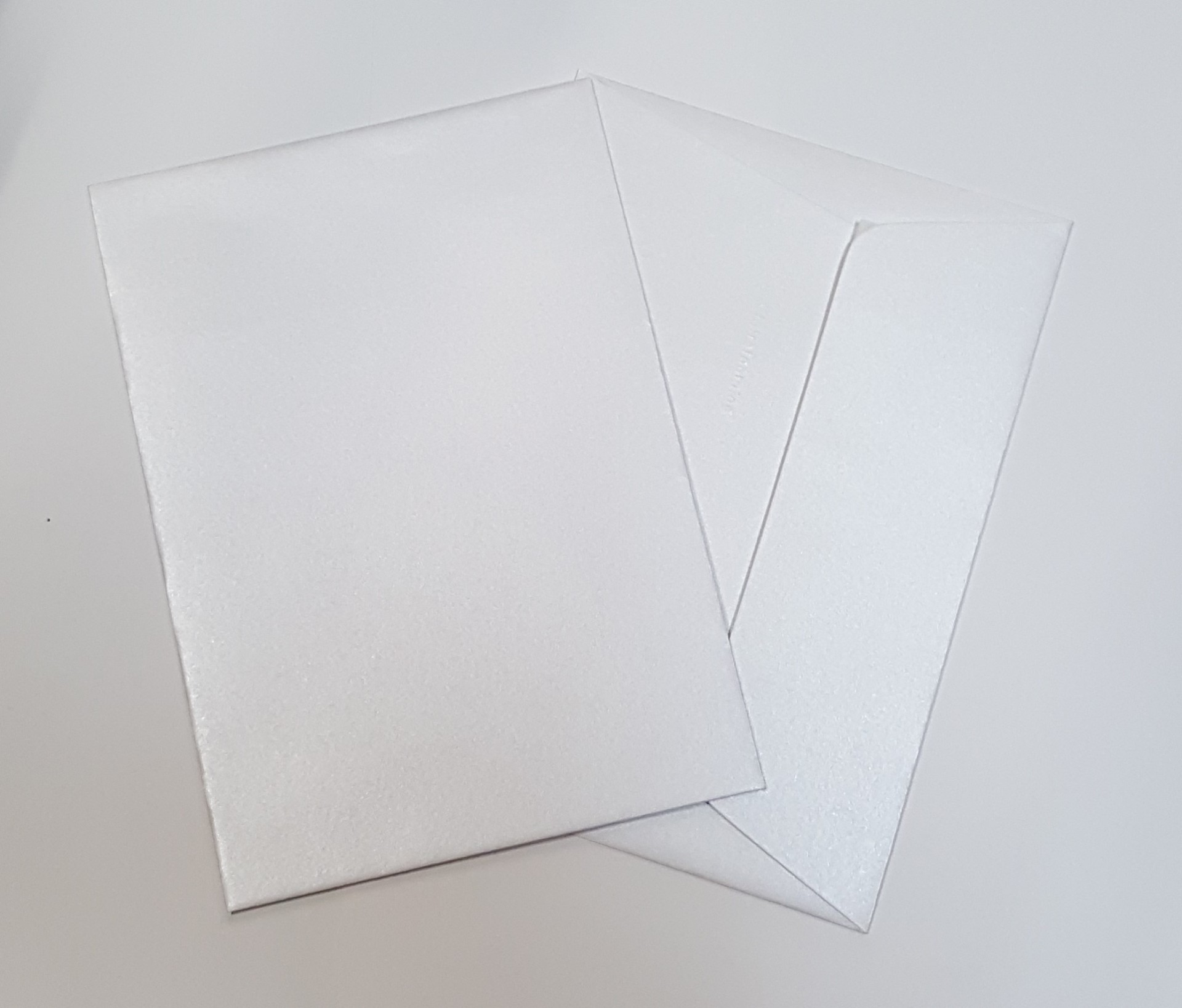 Envelopes C6 metalizados cor pérola