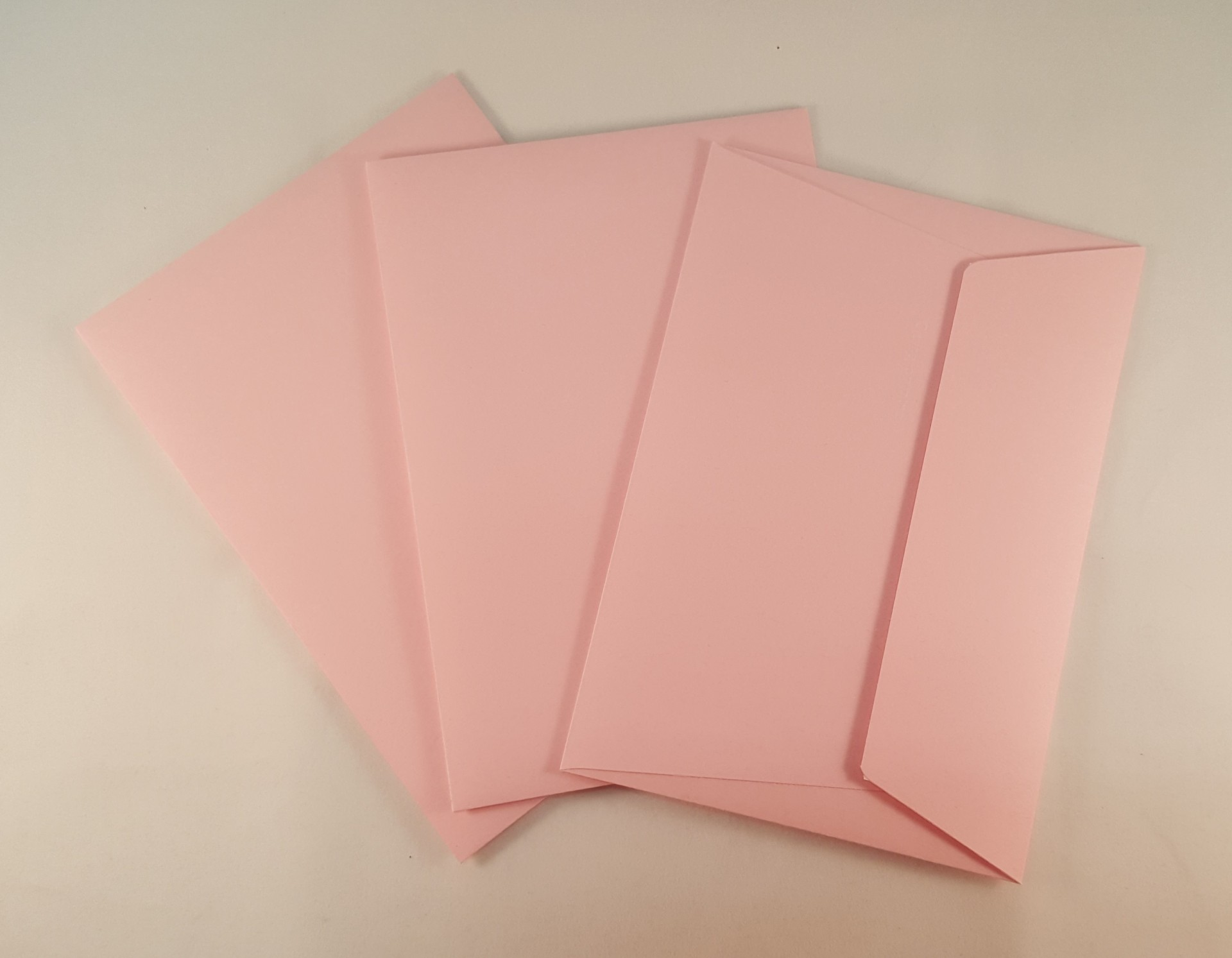 Envelopes C6 coloridos cor rosa claro