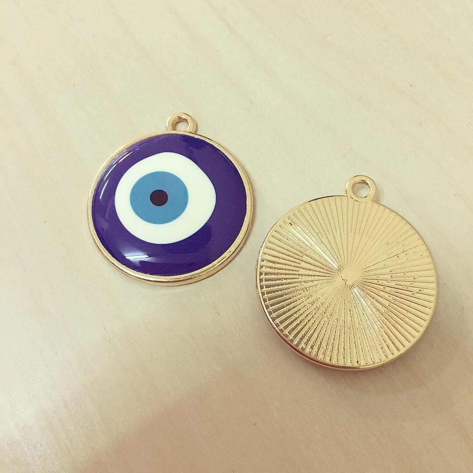 Olho Grande Azul Contorno Dourado