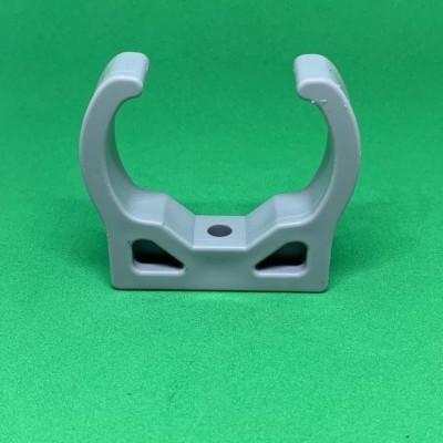 Abraçadeira de mola para perfil furado 49 mm