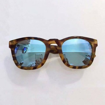 High Contrast Tortoise Isola with sky blue lenses