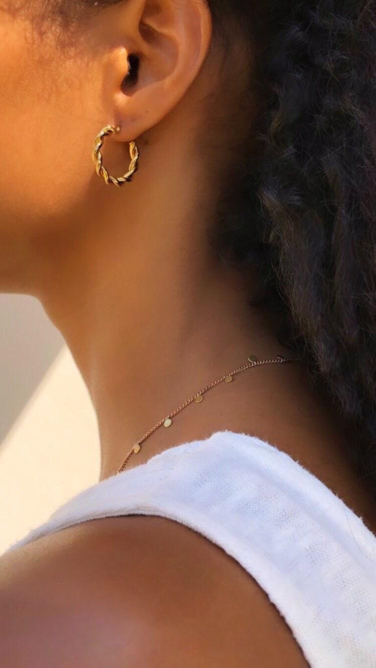 Argolas em aço douradas - Celine